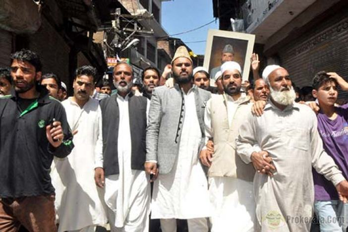 Qazi Yasir with associates