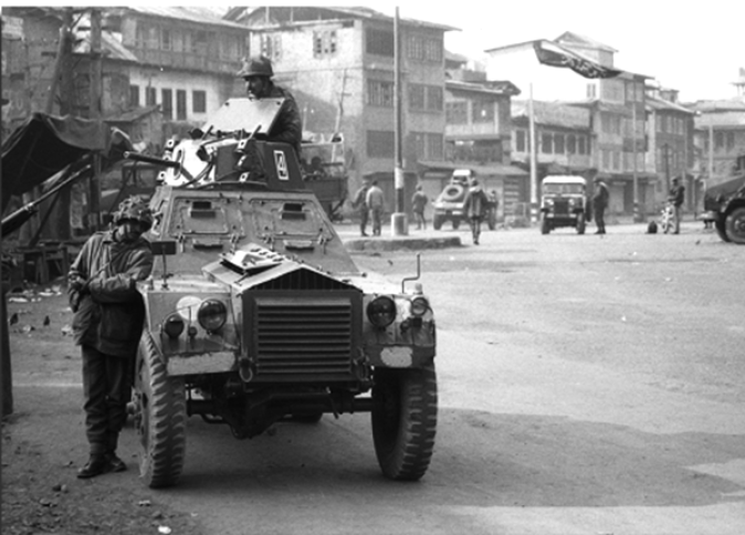Armoured vehicles Patrolling in downtown day after Gaw Kadal Massacre