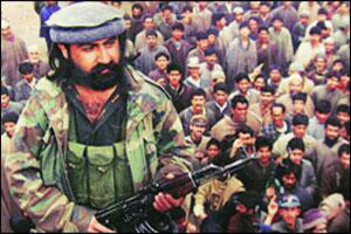 Militant commander Major Mast Gul at an uknown location in Kashmir in 1990s wearing 'Pakol' cap.