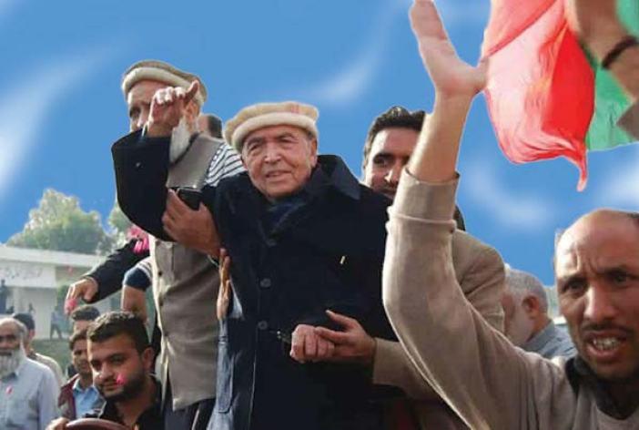 Amanullah Khan addressing a party rally.
