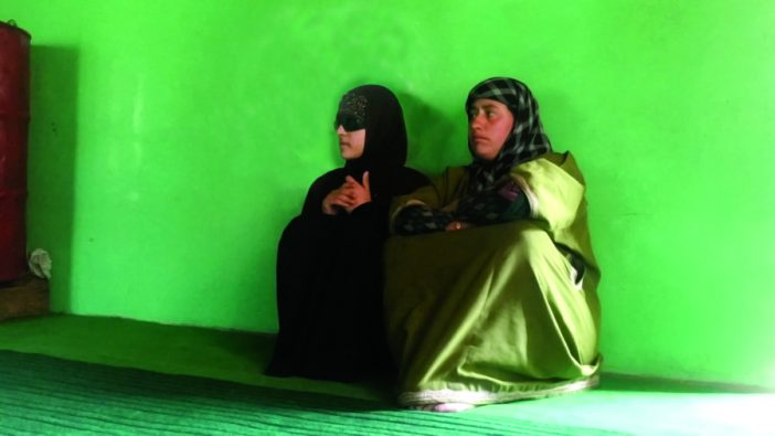 Insha sitting adjacent to her mother in their Sedow Shopian home. (Photo: Aakash Hassan/KL)