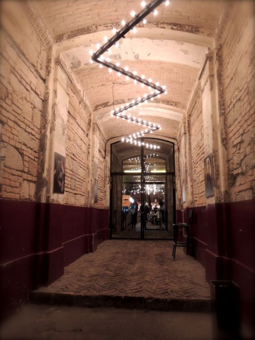 entrance doorway light lights bricks budapest mazel tov bar ruin pub restaurant flow