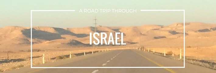 road trip through israel desert rental car driving orange sky endless road