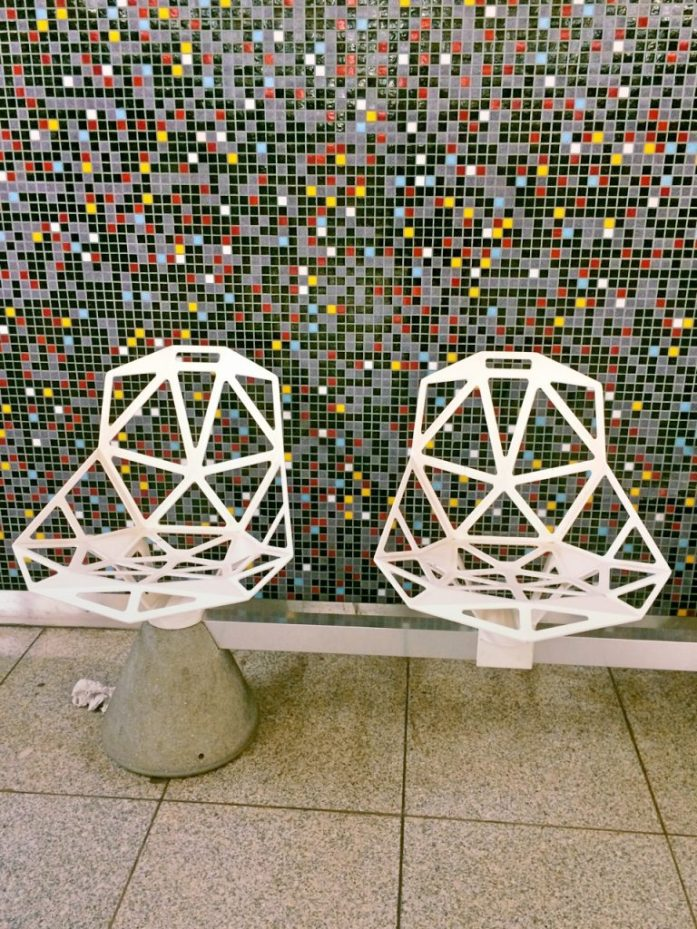 szent gellert ter subway metro stop underground M4 Budapest public transport public sphere architecture station decoration seats seat bench white mosaic