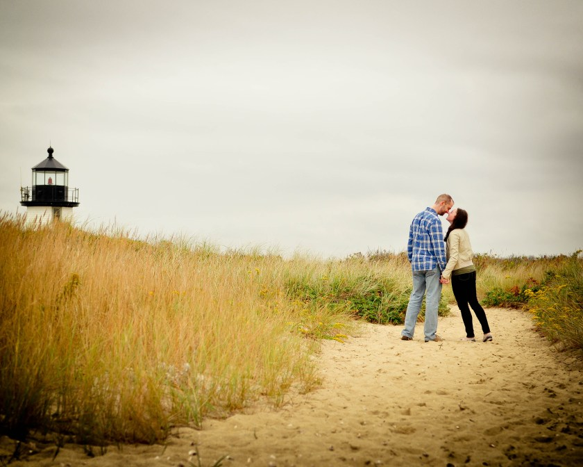 couple in front of a lighthouse, nantucket