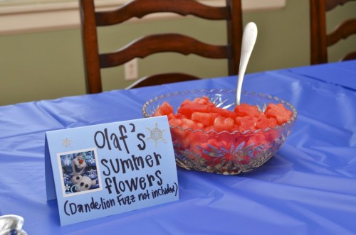 We served lots of Frozen-themed food like Sven's carrots, Olaf's summer flowers, and a blue snowball punch.