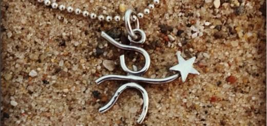 girlie necklace on sand