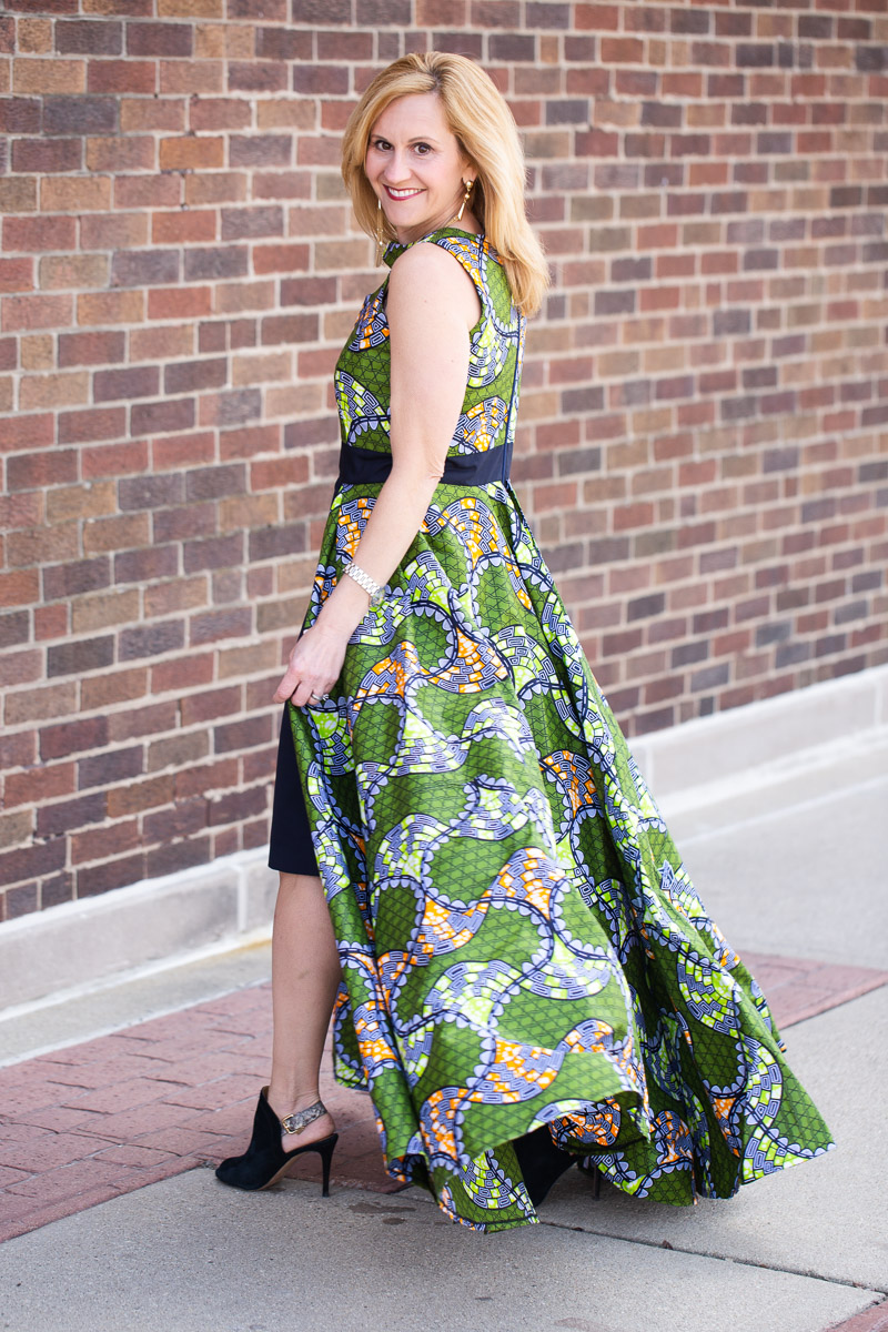 Wearing a green printed dress gown by Sarah from Rahab's Corner