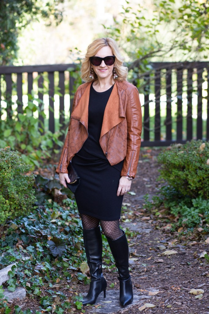 Pairing a waterfall leather jacket with a little black dress.