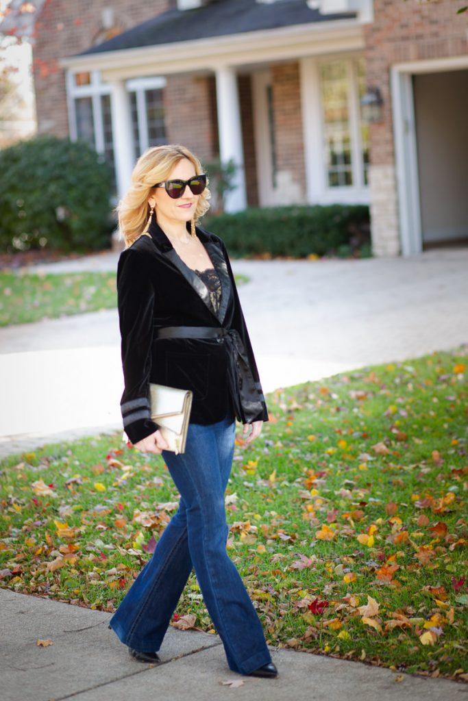 Dressing up flared jeans with a velvet blazer.