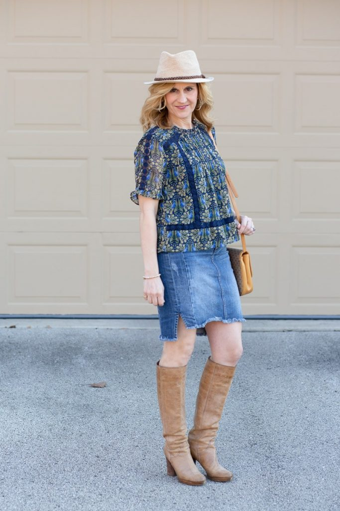 Styling a peacock print lace blouse with a denim pencil skirt and tan knee boots.