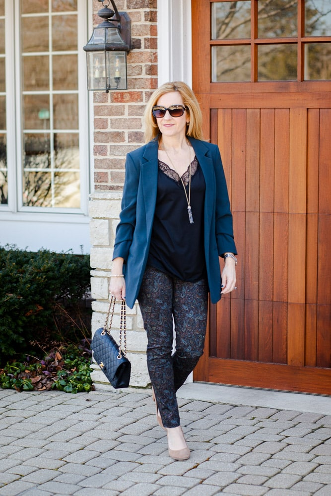 A chic workwear look featuring a boyfriend blazer, lace camisole, and printed pants.