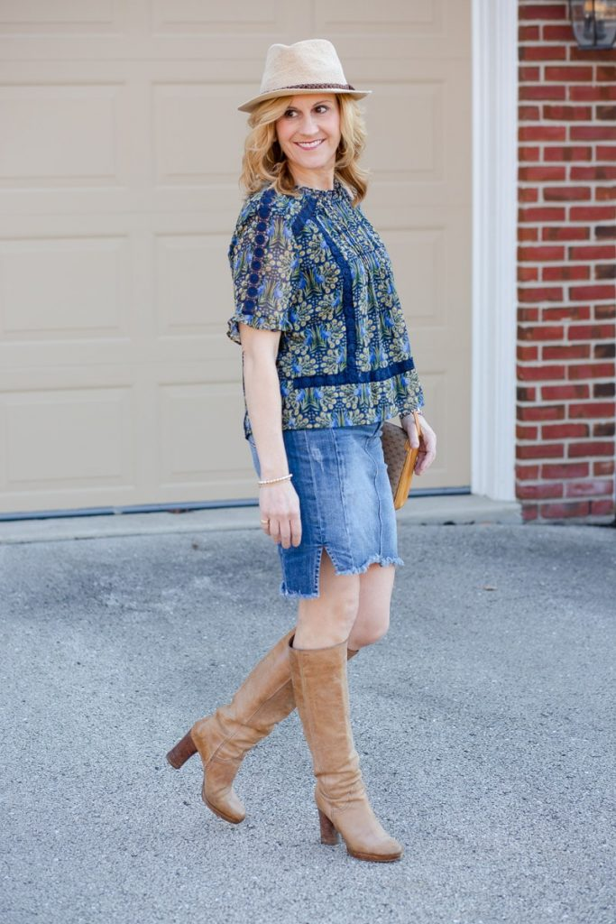 Dressing up a denim skirt with a peacock print blouse.