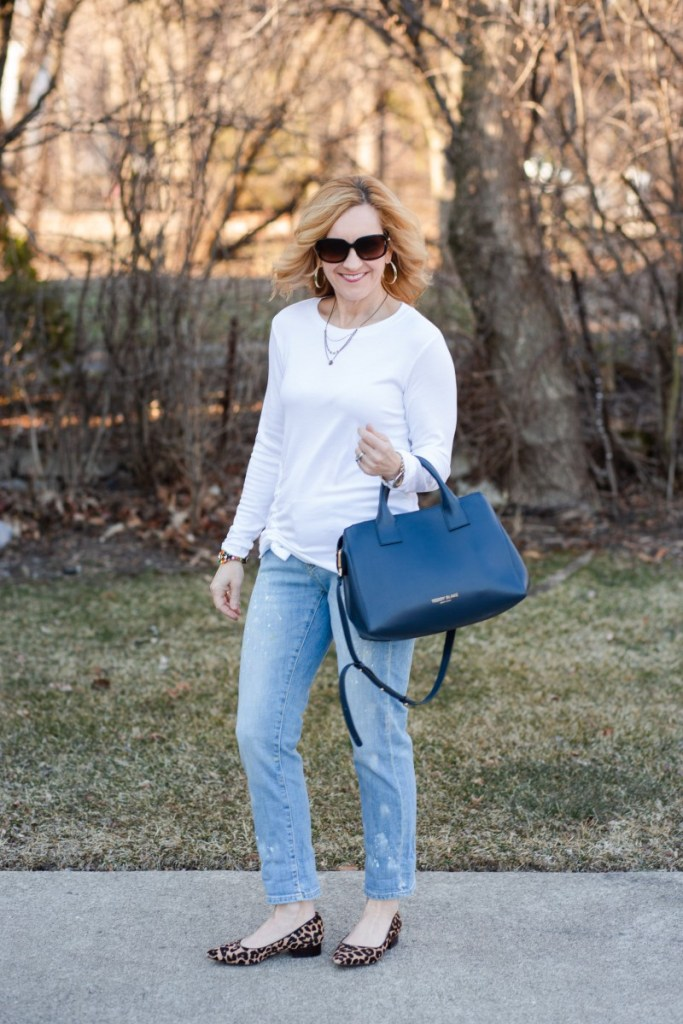 Taking a not so basic white tee and pairing it with paint splattered embroidered jeans.
