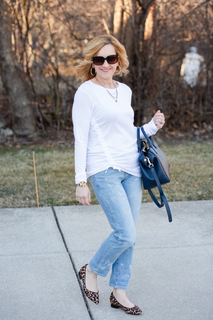 A casual chic look featuring a long sleeved white tee and slim straight jeans.