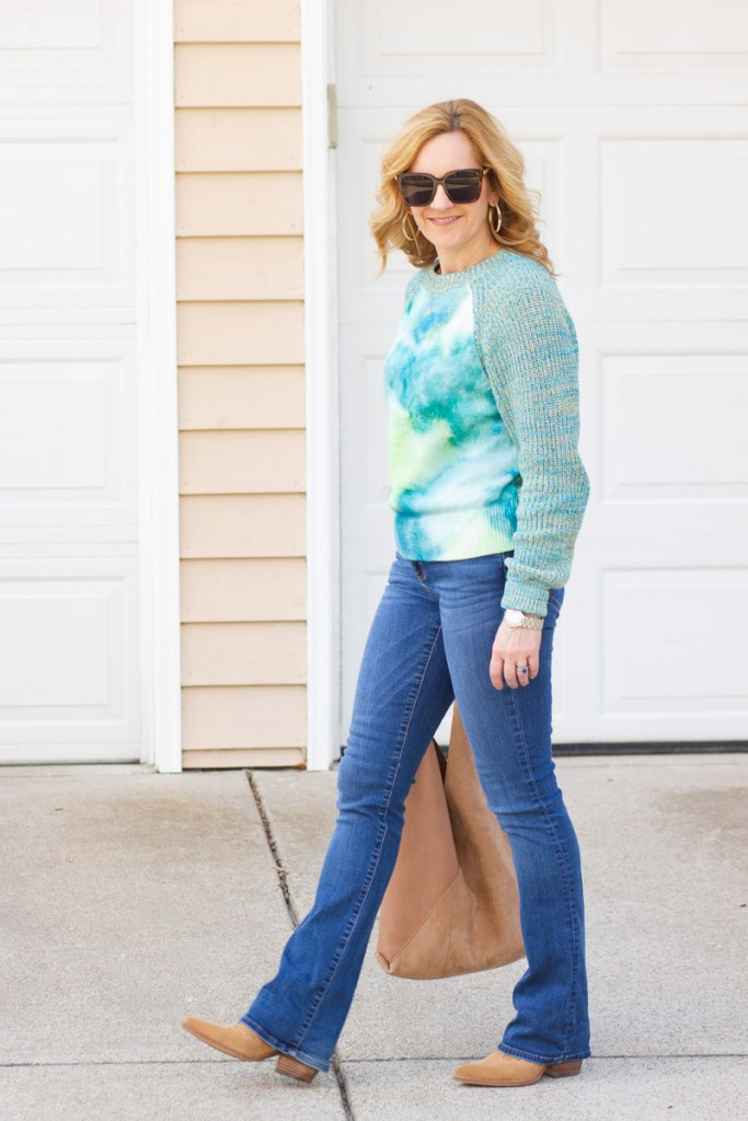 A spring sweater that features a watercolor tie-dyed print.