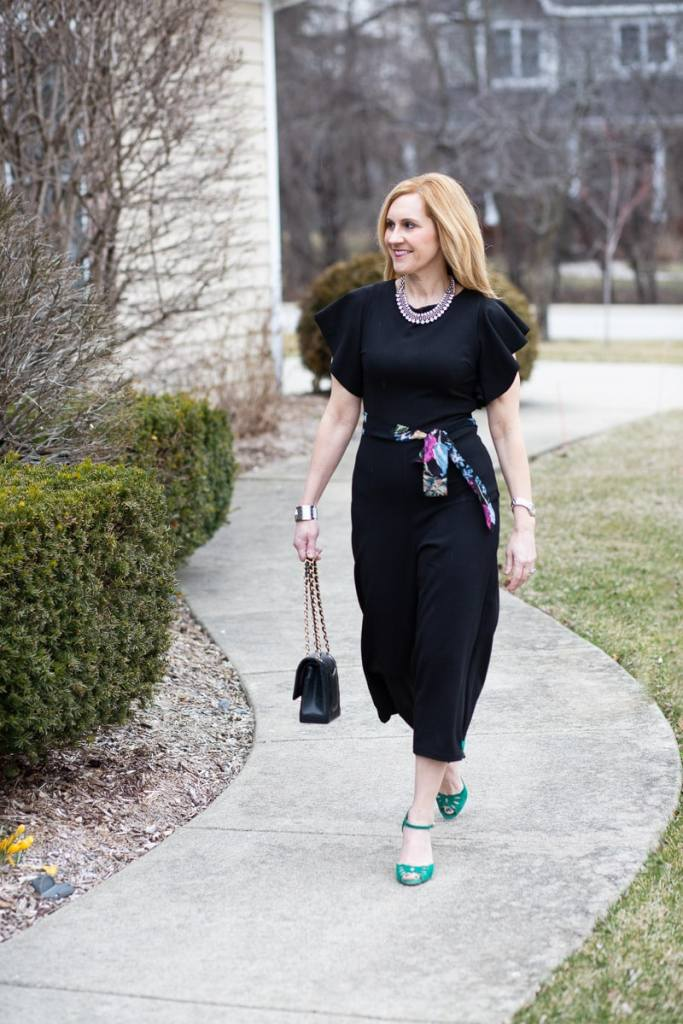 Adding a spring touches to a black jumpsuit.