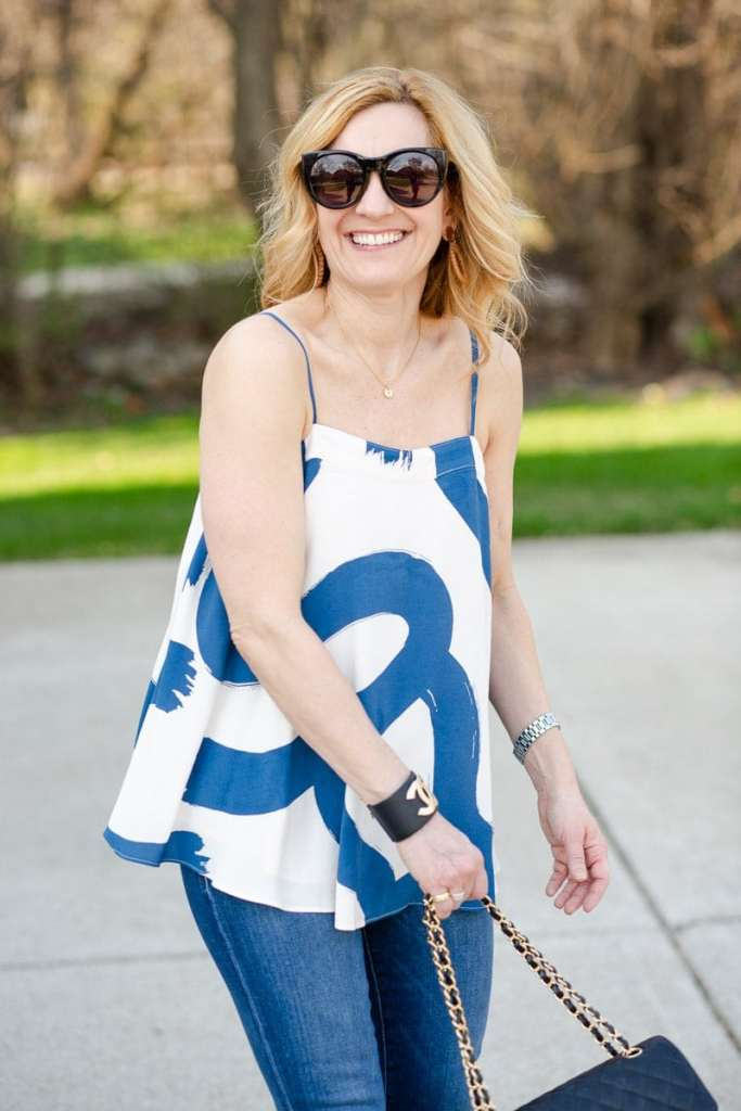 Wearing a chic swing blouse with a blue graphic print.