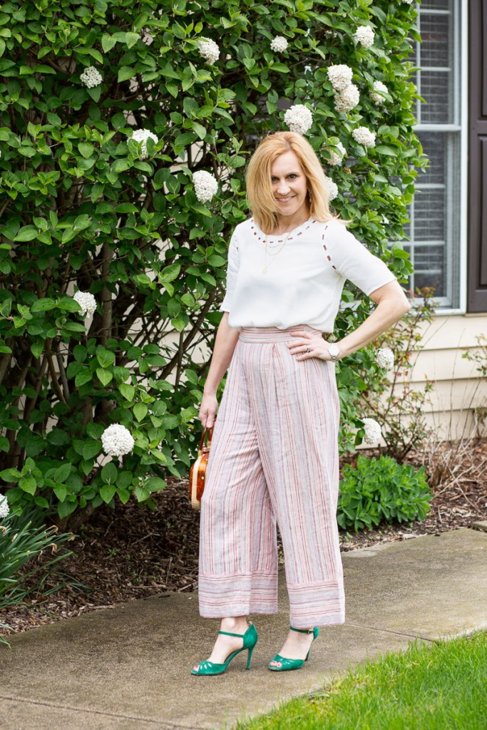 A breezy spring look featuring a white blouse and striped wide leg cropped pants.