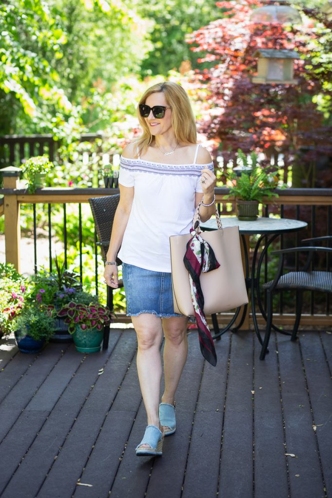 Keeping it classic with a white top and denim skirt.
