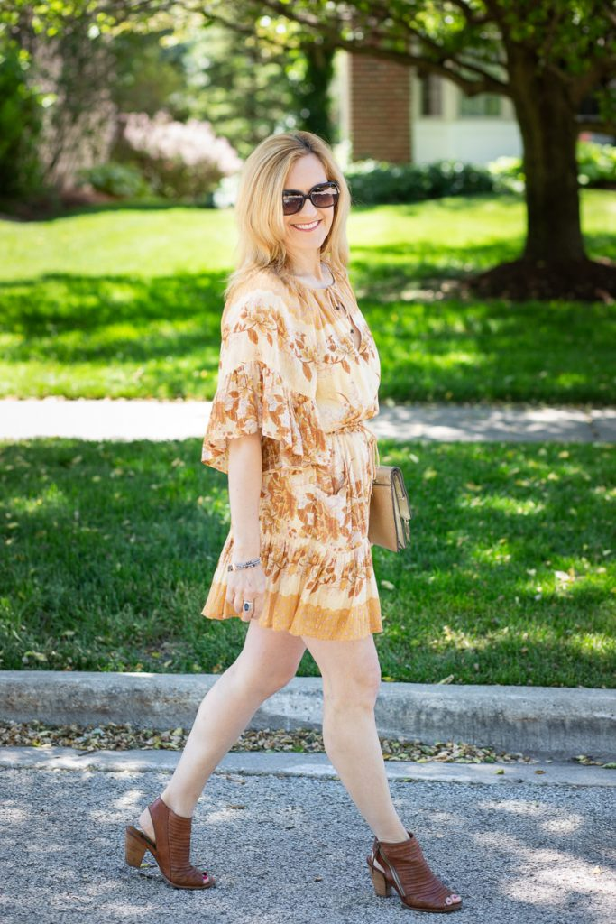 A boho chic summer mini dress paired with open toed sandals.