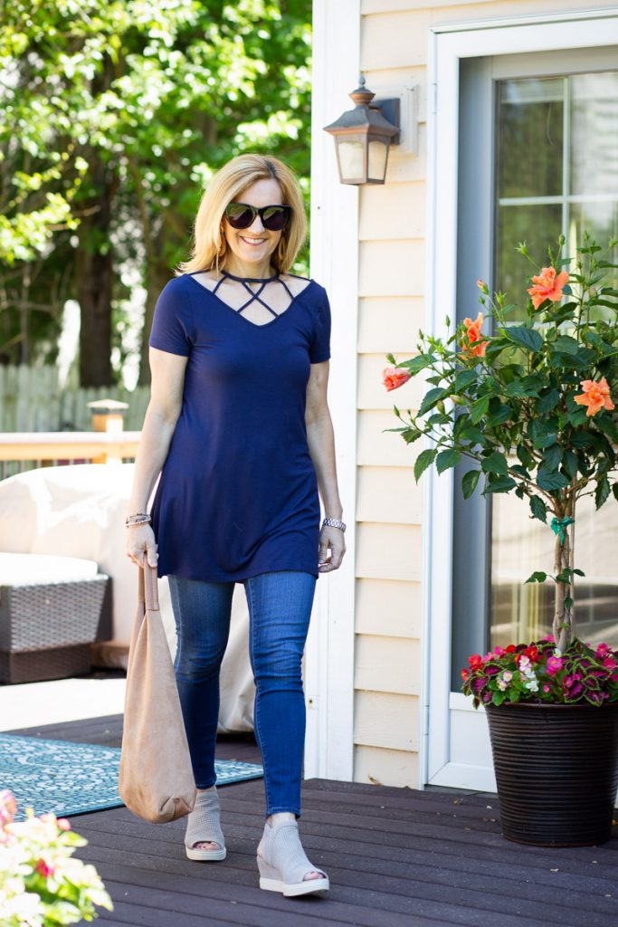 Loving the unique strap details of this navy top from Venus.