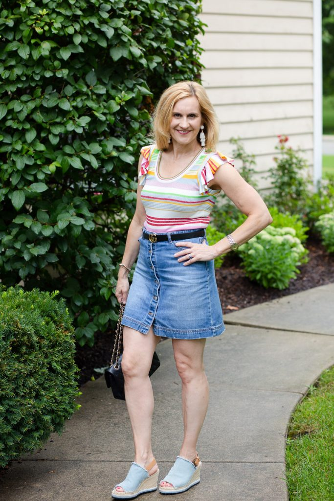 Styling a striped top with a denim mini skirt and wedges.