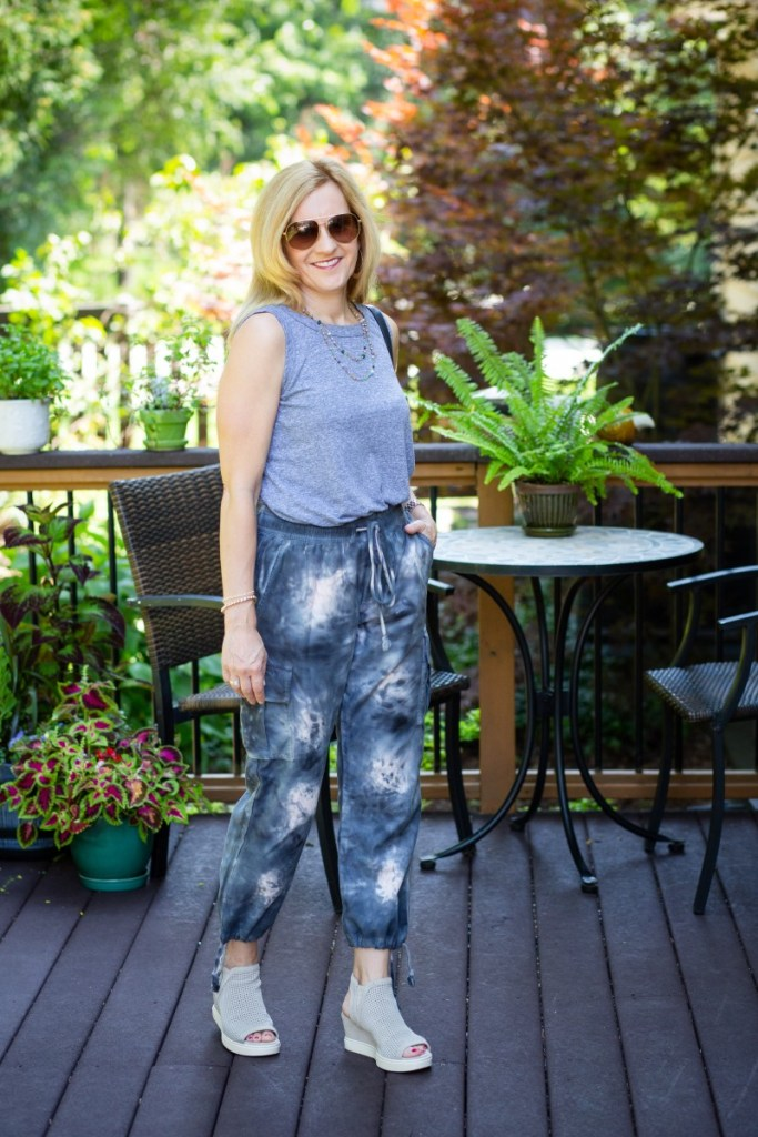 Wearing tie dye joggers with a tank top and wedges.