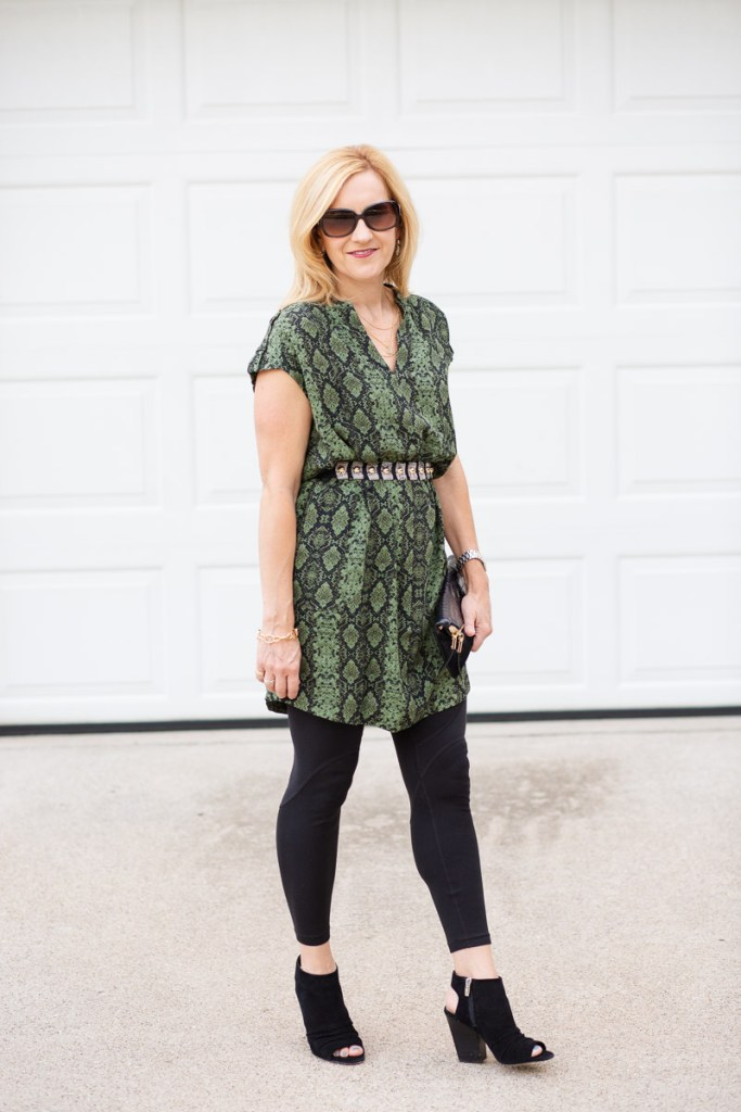 Paring a snakeskin tunic dress with a waist belt and leggings