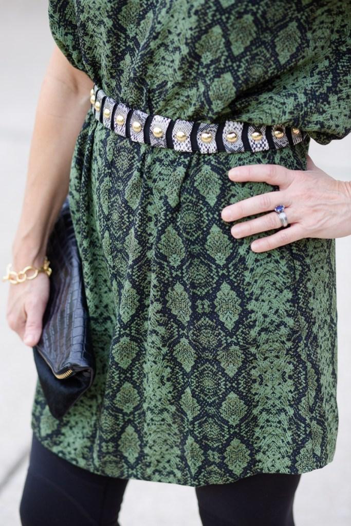 Adding a snakeskin waistbelt to a green snakeskin tunic dress.