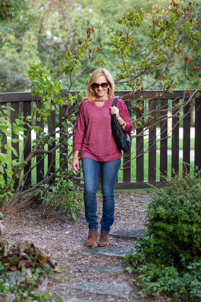 Wearing an athleisure top with jeans for a cool casual look.