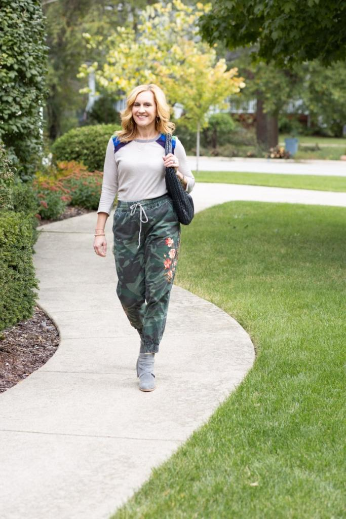 Wearing my camouflage joggers with suede booties and a unique color blocked tee.