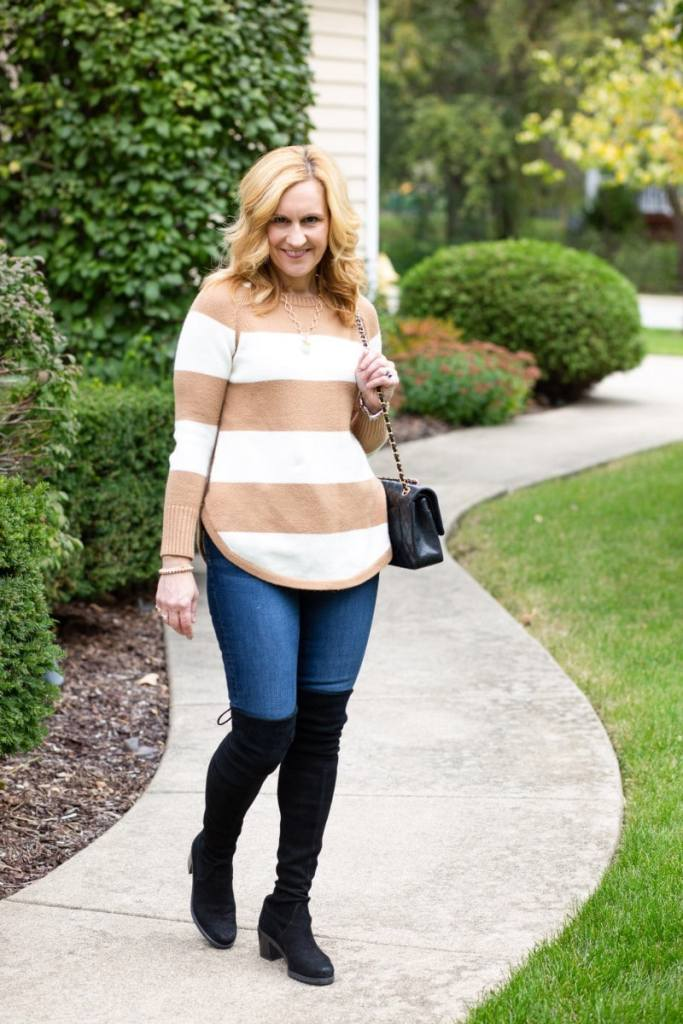 Wearing a striped sweater tunic with skinny jeans and OTK boots.