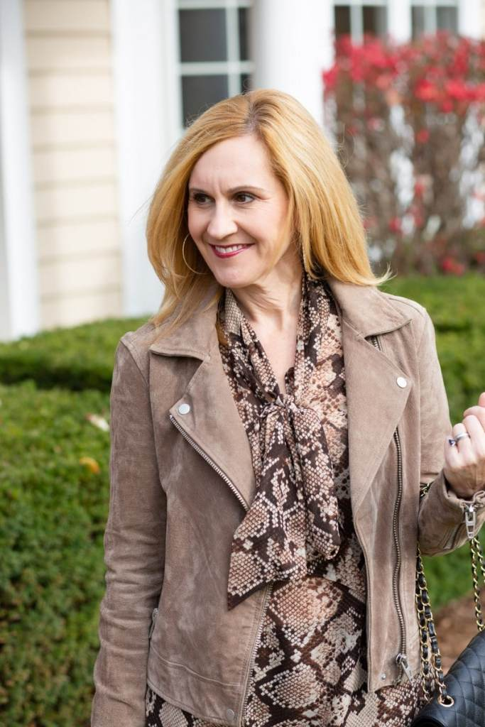 Wearing my suede Moto jacket with a snakeskin bow blouse.