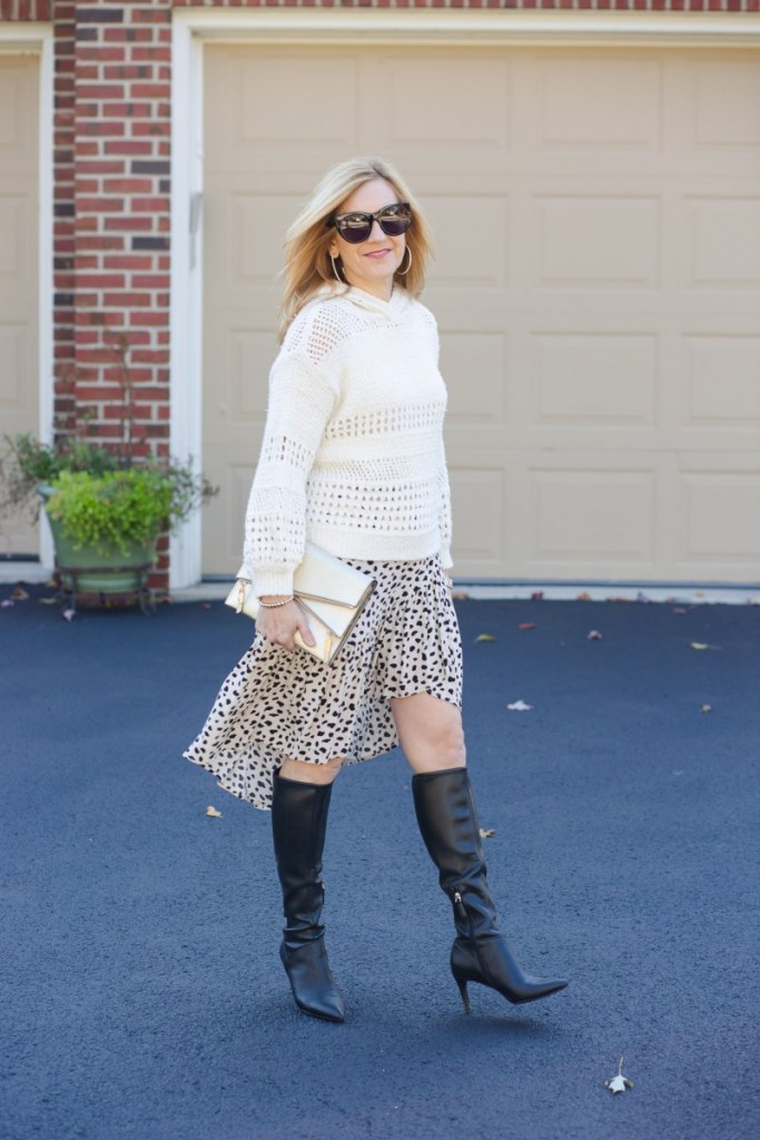 Paring a hoodie sweater with a high-low ruffle skirt.