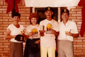 Dad (center) holding a trophy from their sailing club