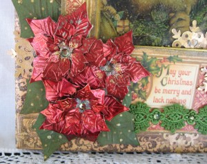 Poinsettias in the corner are made using Spellbinder's dies, metal foil and alcohol inks.