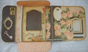 Interior of the memory file.  All panels have been stitched and distressed.  Frames are mounted on foam tape with one edge left open so that photos can easily be inserted.  There is also room for journaling.