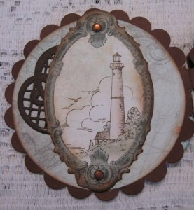 The first panel features another lighthouse from the cutapart page.  It is secured with copper brads, adding to the vintage feel of this panel.  A snippet of the Decorative Lattice Swirl Die is  glued under the image.