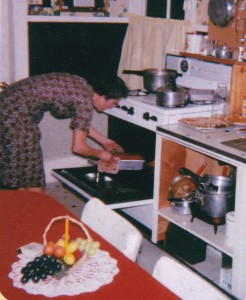 This is how I remember Mom best...pulling freshly baked loaves of bread out of the oven.  Best bread I ever had!