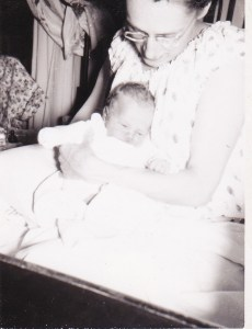 Mom, holding me just a few hours after I was born.  I love that she has her hair up in pincurls, so she would look pretty for Dad when he came to visit.