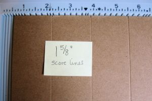 "Begin with a 5x7 kraft card base.  Open it flat on your scoring tool.  Score every 1 5/8"" until you reach the center of the card."