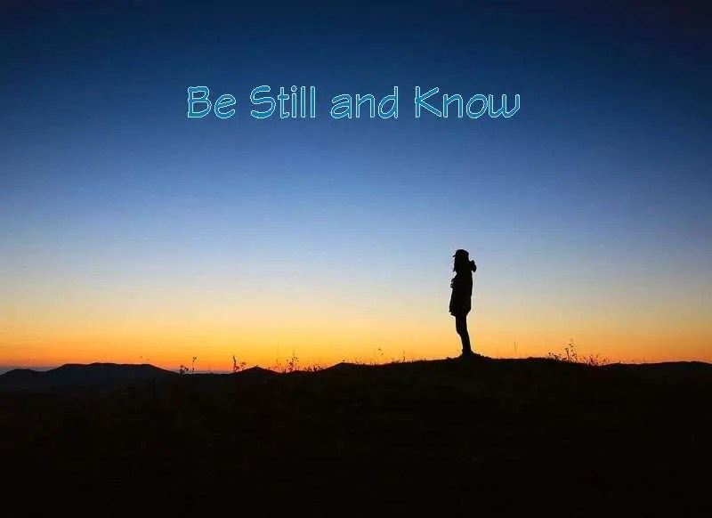 A man silhouetted by the sunset on the horizon with the title Be Still and Know.