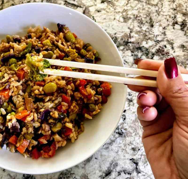 vegetable fried rice with chop sticks
