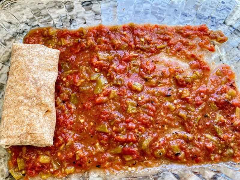 vegan enchiladas fold and place in panjpg