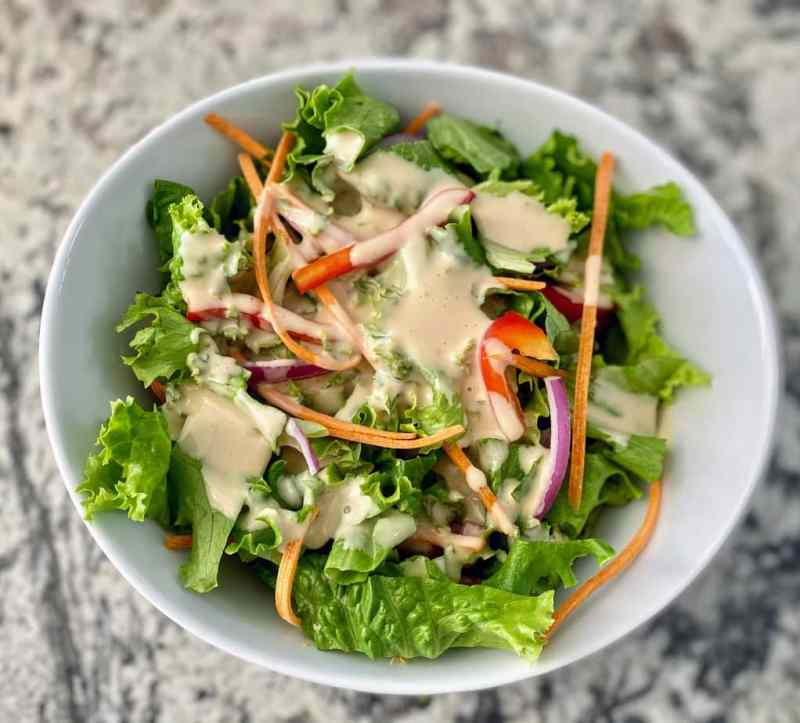 green salad with miso tahini dressing