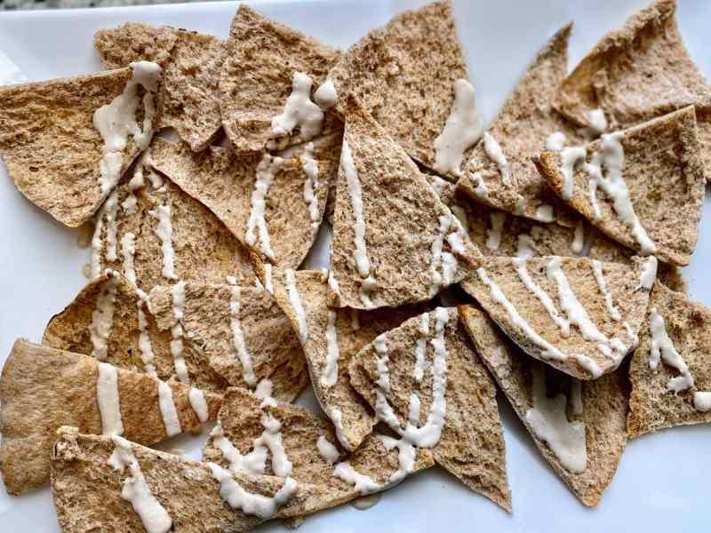 Tahini drizzled on pita bread