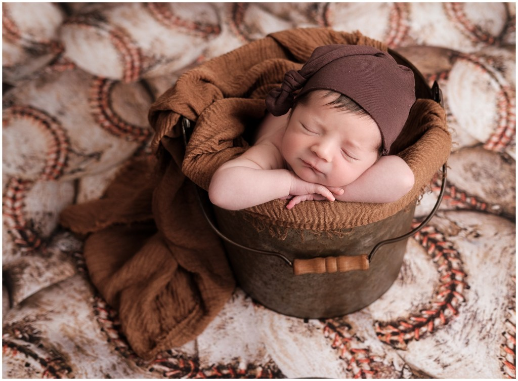 Macomb Posed Studio Newborn Photographer Baby Boy in bucket with baseballs