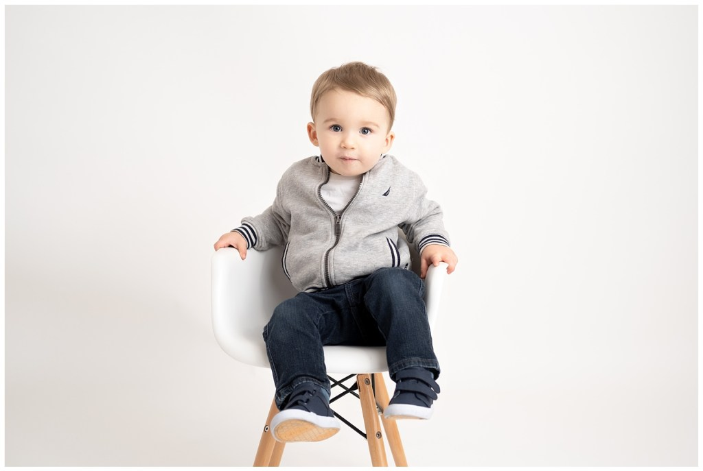 boy in chair on white background