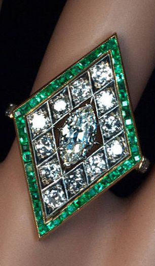 Marquise Cut Diamond and Emerald Ring